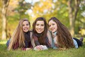 picture of bff  - Three happy Caucasian teen girls sitting together - JPG