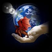 Red Dragon On A Hand On A Background Of The Earth
