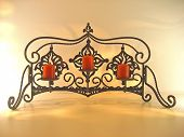 foto of bric-a-brac  - Fancy wrought iron candle holder with red votive candles - JPG