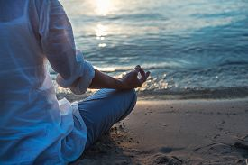 image of moonlight  - Woman meditating at the sea in the moonlight - JPG