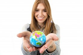 pic of globe  - young beautiful student girl holding little world globe in her hands choosing holidays destination in travel and vacation tourism concept isolated on white background - JPG