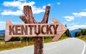 stock photo of bluegrass  - Kentucky wooden sign with road background - JPG