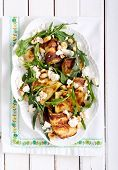 picture of rocket salad  - Zucchini rocket feta and nut salad on plate - JPG