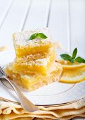 picture of icing  - Tangy lemon squares with icing sugar on plate - JPG