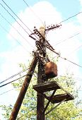 image of transmission lines  - Old wooden electric pole with wires  - JPG