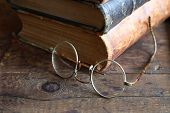 picture of spectacles  - Vintage still life with stack of old book near spectacles - JPG