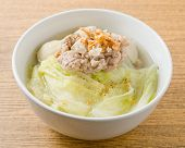 picture of thai cuisine  - Thai Cuisine and Food Bowl of Lettuce with Minced Pork and Fish Meat Ball Soup Topping with Fried Garlic - JPG
