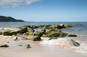 pic of anglesey  - Rocky breakwater on beach at Bennlech Anglesey North Wales - JPG