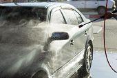 pic of pressure-wash  - The process of car washing high pressure water at the carwash - JPG