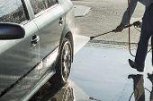 foto of pressure-wash  - The process of washing the car at the car wash - JPG