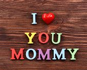 stock photo of mummy  - Inscription I LOVE YOU MUMMY made of colorful letters on wooden background - JPG