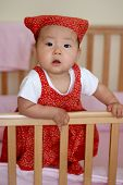 Pretty Asian Baby In Red Dress And Bandana