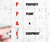 foto of ppe  - Hand of a business man completing the puzzle with the last missing piece - JPG