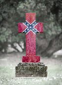 stock photo of flag confederate  - Old weathered gravestone in the cemetery  - JPG