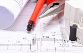 image of electrical engineering  - Rolls of electrical diagrams electric fuse and work tools lying on construction drawing of house drawings for the projects engineer jobs - JPG