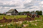 foto of backhoe  - backhoe is digging a ditch - JPG
