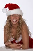 Female Santa In Red Dress And Hat Leaning On Elbows