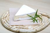 picture of brie cheese  - Brie cheese with wallnuts and terragon on wood background - JPG