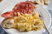 picture of scrambled eggs  - Scrambled eggs with bacon and bread for breakfast  - JPG
