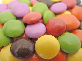foto of bonbon  - pile of various colored small chocolate bonbons - JPG