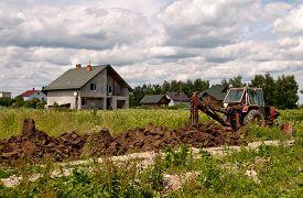 stock photo of backhoe  - backhoe is digging a ditch - JPG