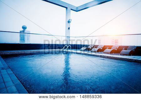 hotel swimming pool at rooftop,blue toned,wuxi,china.