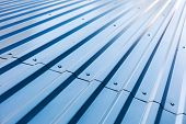 Blue Corrugated Metal Roof With Rivets poster