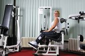 Mature healthy woman work out in fitness