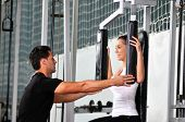 image of personal trainer  - woman in the fitness gim working out with personal trainer coach - JPG