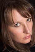 Woman Portrait On Black Backdrop