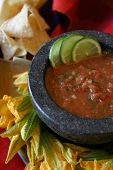 Red Salsa Fresca in a stone mortar