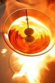image of ouzo  - Two olive classic martini with flaming background - JPG