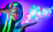 Fashion model woman in neon light, beautiful model girl, painted fluorescent make-up, Body Art desig poster