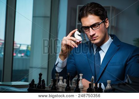Businessman playing chess in strategy