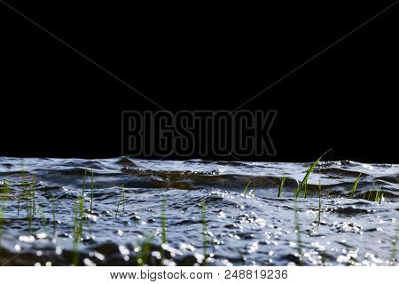 poster of Big Windy Waves Splashing Over Rocks. Wave Splash In The Lake On Black Background. Waves Breaking On