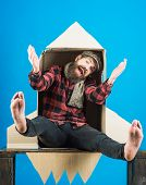 Happy Bearded Man In Checkered Shirt Sit In Cardboard Rocket. Adventure Concept. Happy Man Flying To poster