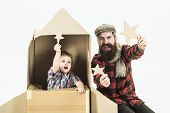Boy Sit In Cardboard Space Rocket, Points Up By Star. Father`s Day. Happy Family Playing With Cardbo poster