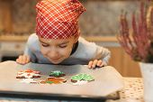 Child Looking To Colorful Cookies On Baking Tray. Smiling Boy Anticipating How Tasty Are Fresh Baked poster
