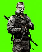 portrait of full armed young soldier against a removable chroma key background