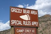 stock photo of grizzly bears  - Grizzly Bear Area Warning Sign outside Yellowstone National Park - JPG