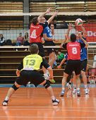 KAPOSVAR, HUNGARY - OCTOBER 29: Unidentified players in action at a Hungarian National Championship volleyball game Kaposvar (blue) vs. Szolnok (red), October 29, 2011 in Kaposvar, Hungary.