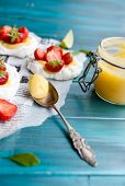 Mini pavlovas with strawberries and lime poster