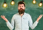 Man With Beard And Mustache On Confused Face Stand In Front Of Chalkboard. Bearded Hipster In Shirt, poster