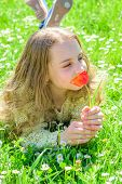 Child Enjoy Aroma Of Tulip While Lying At Meadow, Close Up. Tenderness Concept. Girl With Long Hair  poster