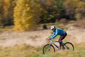 Autumn mountain biking - female on bike