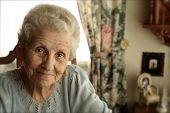 picture of elderly woman  - Elderly Woman With Bright Eyes Indoors Smiling - JPG