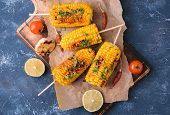 Grilled Corn Cobs. Delicious Summer Snack. With Parsley, Chili Peppers, Lime And Grilled Garlic. Ser poster