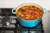 Stock Simmering Gently In A Pot On A Gas Stove