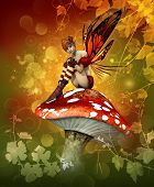 stock photo of magical-mushroom  - a little fairy is sitting on a fly agaric - JPG