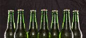 Closeup Of Chilled Beer. Brewed Beer In Bottles On Wooden Table On Black Background, Summer Party poster